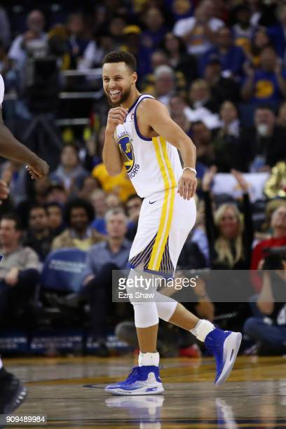 Stephen Curry of the Golden State Warriors reacts after making a threepoint basket against the New York Knicks at ORACLE Arena on January 23 2018 in...