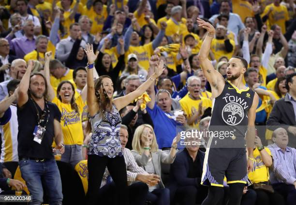 Stephen Curry of the Golden State Warriors reacts after making a threepoint basket against the New Orleans Pelicans during Game Two of the Western...