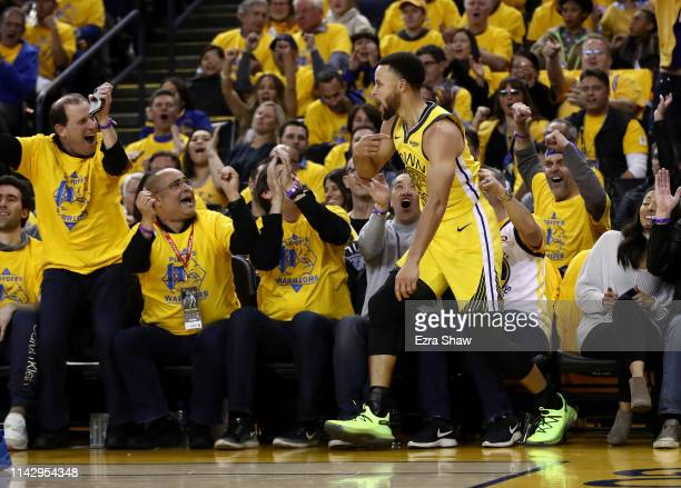 Stephen Curry of the Golden State Warriors reacts after making a shot against the LA Clippers during Game Two of the first round of the 2019 NBA...