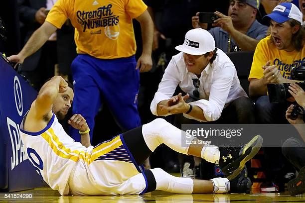 Stephen Curry of the Golden State Warriors reacts after making a shot and drawing a foul against the Cleveland Cavaliers in Game 7 of the 2016 NBA...