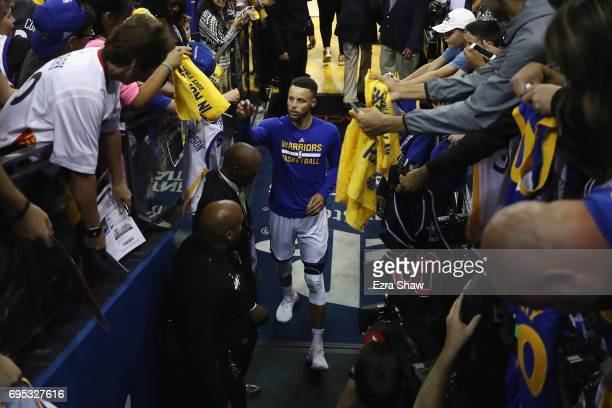 Stephen Curry of the Golden State Warriors reacts after making a shot from the tunnel during warmups prior to Game 5 of the 2017 NBA Finals at ORACLE...