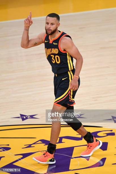 Stephen Curry of the Golden State Warriors reacts after scoring a three point basket against Los Angeles Lakers during the second half of an NBA...