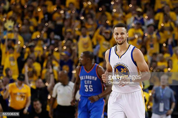 Stephen Curry of the Golden State Warriors reacts after scoring against the Oklahoma City Thunder during game one of the NBA Western Conference...