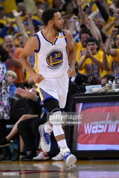 Stephen Curry of the Golden State Warriors reacts after scoring against the San Antonio Spurs during Game One of the NBA Western Conference Finals at...