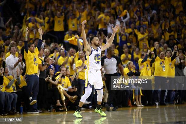 Stephen Curry of the Golden State Warriors reacts after the Warriors made a basket against the LA Clippers during Game One of the first round of the...