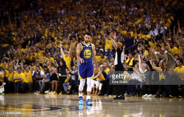 Stephen Curry of the Golden State Warriors reacts after the Warriors made a basket at the end of the first quarter against the LA Clippers during...