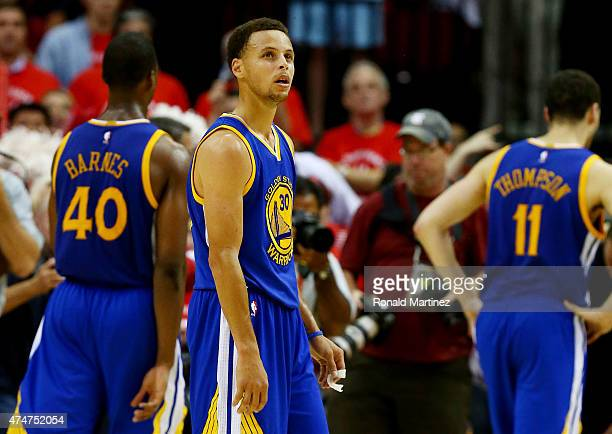 Stephen Curry of the Golden State Warriors reacts after their 128 to 115 loss to the Houston Rockets in Game Four of the Western Conference Finals of...