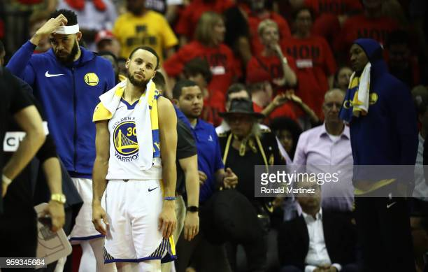 Stephen Curry of the Golden State Warriors reacts after they were defeated 127 to 105 by the Houston Rockets in Game Two of the Western Conference...