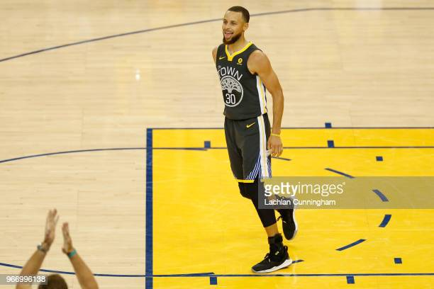 Stephen Curry of the Golden State Warriors reacts against the Cleveland Cavaliers during the fourth quarter in Game 2 of the 2018 NBA Finals at...