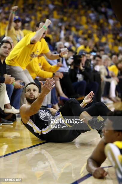 Stephen Curry of the Golden State Warriors reacts against the Toronto Raptors in the first half during Game Four of the 2019 NBA Finals at ORACLE...