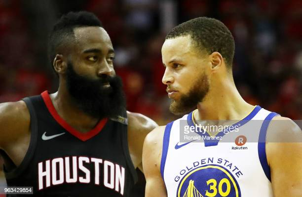 Stephen Curry of the Golden State Warriors reacts as James Harden of the Houston Rockets looks on in the third quarter of Game Seven of the Western...