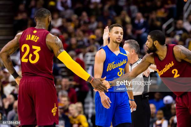 Stephen Curry of the Golden State Warriors reacts as LeBron James of the Cleveland Cavaliers and Kyrie Irving celebrate after scoring during the...