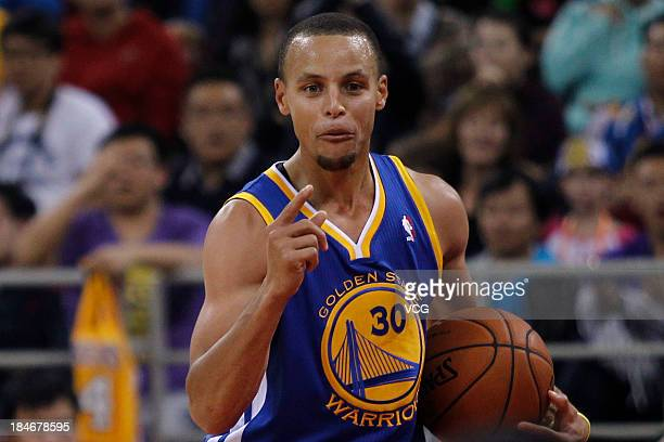 Stephen Curry of the Golden State Warriors reacts during a game against the Los Angeles Lakers during the 2013 Global Games at the MasterCard Center...