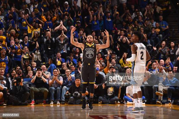 Stephen Curry of the Golden State Warriors reacts during the game against the Memphis Grizzlies on December 30 2017 at ORACLE Arena in Oakland...