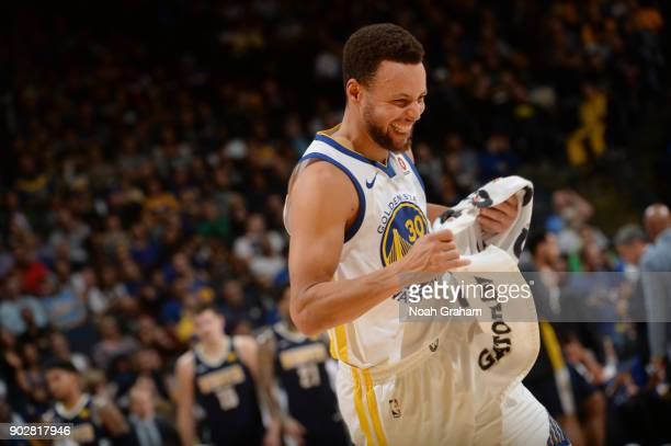 Stephen Curry of the Golden State Warriors reacts during the game against the Denver Nuggets on January 8 2018 at ORACLE Arena in Oakland California...