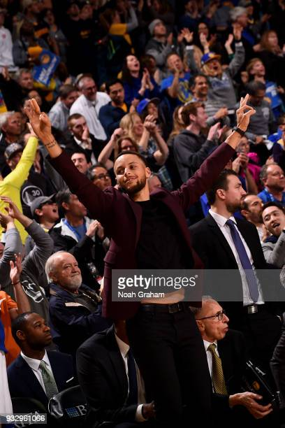 Stephen Curry of the Golden State Warriors reacts during the game against the Sacramento Kings on March 16 2018 at ORACLE Arena in Oakland California...