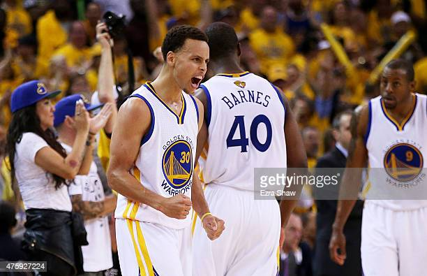 Stephen Curry of the Golden State Warriors reacts in overtime against the Cleveland Cavaliers during Game One of the 2015 NBA Finals at ORACLE Arena...
