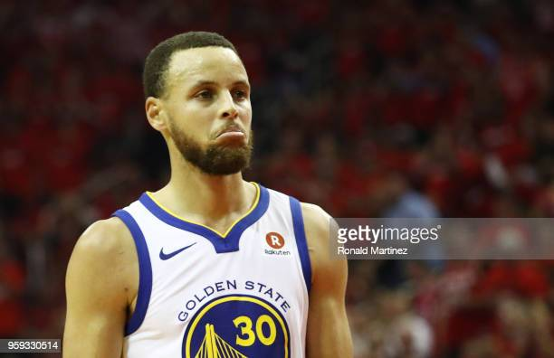 Stephen Curry of the Golden State Warriors reacts in the first half against the Houston Rockets of Game Two of the Western Conference Finals of the...