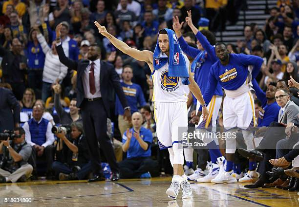 Stephen Curry of the Golden State Warriors reacts on the bench after Marreese Speights of the Golden State Warriors made a threepoint basket against...