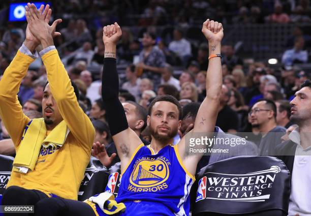 Stephen Curry of the Golden State Warriors reacts on the bench in the second half against the San Antonio Spurs during Game Four of the 2017 NBA...