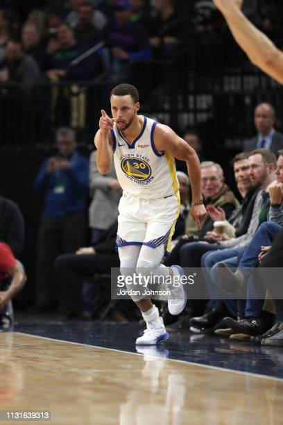 Stephen Curry of the Golden State Warriors reacts to a play during the game against the Minnesota Timberwolves on March 19 2019 at Target Center in...