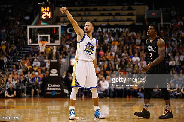 Stephen Curry of the Golden State Warriors reacts to a three point shot against the Phoenix Suns during the NBA game at Talking Stick Resort Arena on...