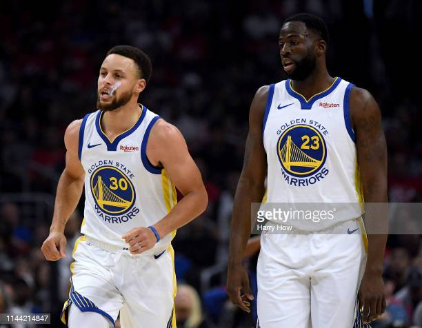 Stephen Curry of the Golden State Warriors reacts to his second foul with Draymond Green during the first half against the LA Clippers in Game Four...