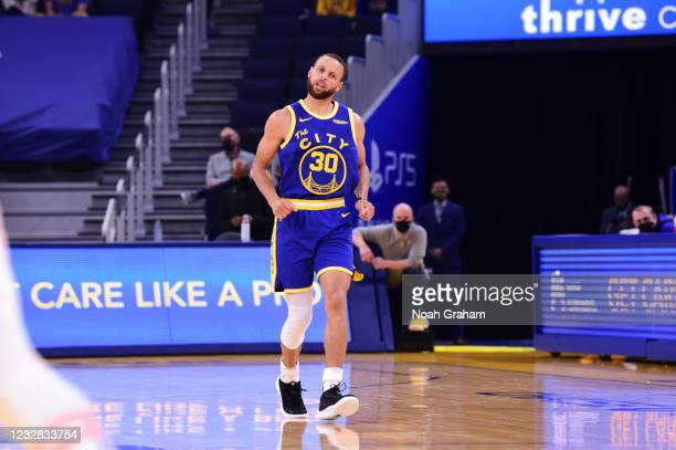 Stephen Curry of the Golden State Warriors reacts to his three point basket during the game against the Phoenix Suns on May 11, 2021 at Chase Center...