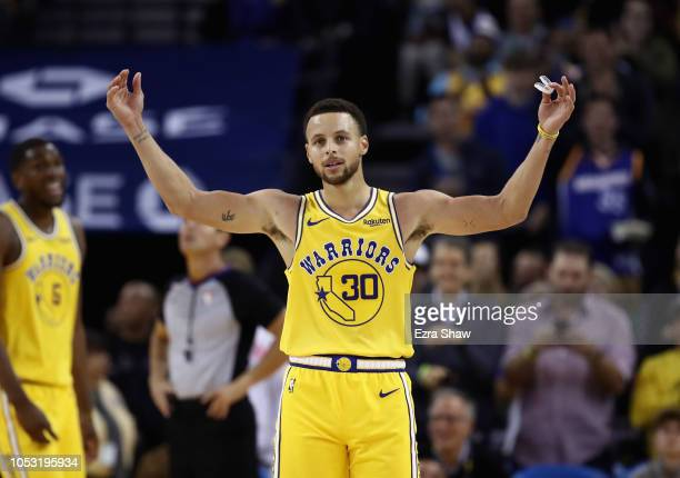 Stephen Curry of the Golden State Warriors reacts to the crowd chanting MVP during their game against the Washington Wizards at ORACLE Arena on...