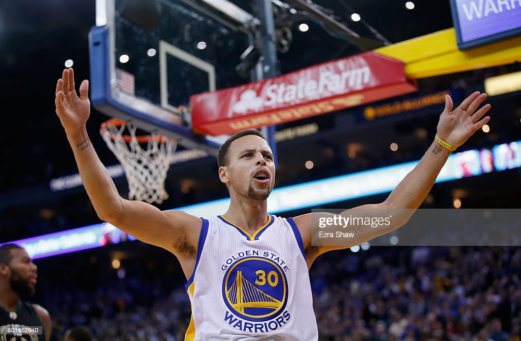 Stephen Curry #30 of the Golden State Warriors reacts towards the crowd during their game against the Milwaukee Bucks at ORACLE Arena on December 18, 2015 in Oakland, California.