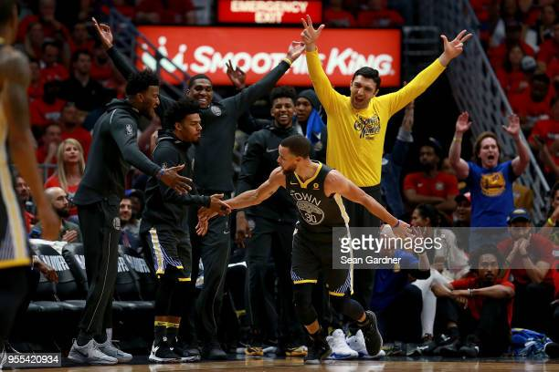 Stephen Curry of the Golden State Warriors reacts with his team after scoring a three pointer against the New Orleans Pelicans during the first half...