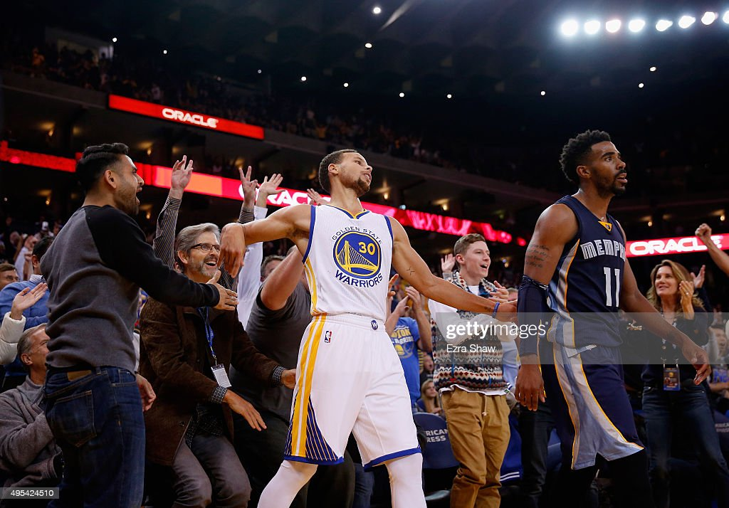 Stephen Curry #30 of the Golden State Warriors reacts with the crowd after he made a three-point basket over Mike Conley #11 of the Memphis Grizzlies at ORACLE Arena on November 2, 2015 in Oakland, California.