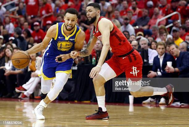 Stephen Curry of the Golden State Warriors rives around Austin Rivers of the Houston Rockets during Game Six of the Western Conference Semifinals of...