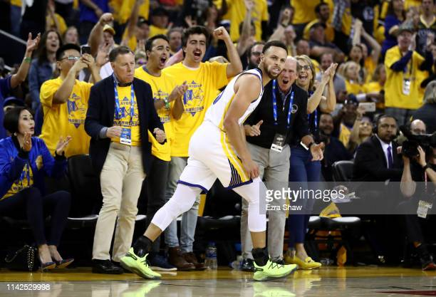 Stephen Curry of the Golden State Warriors runs back down court after making a basket against the LA Clippers during Game One of the first round of...