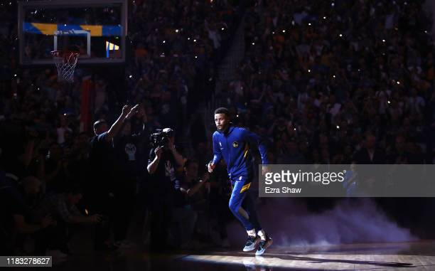 Stephen Curry of the Golden State Warriors runs out on too the court for player introductions before their game against the LA Clippers at Chase...