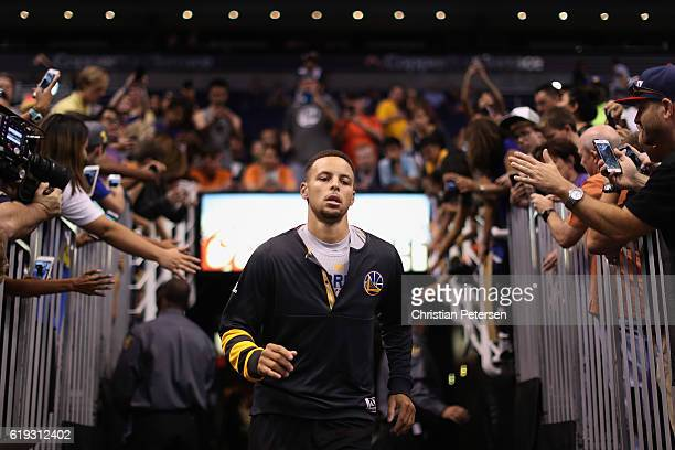 Stephen Curry of the Golden State Warriors runs out onto the court before the NBA game against the Phoenix Suns at Talking Stick Resort Arena on...