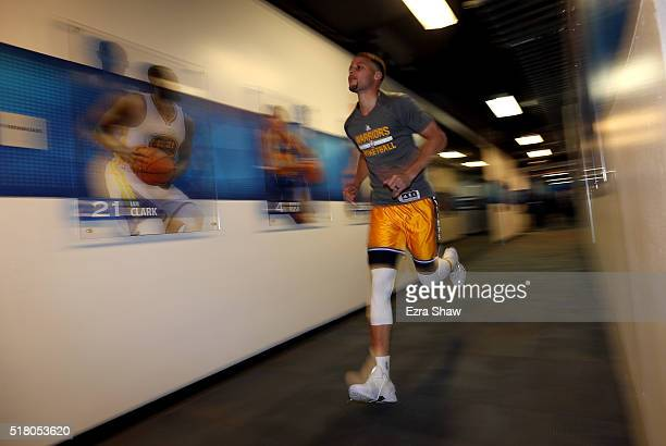 Stephen Curry of the Golden State Warriors runs through the tunnel to the court to warm up before their game against the Washington Wizards at ORACLE...