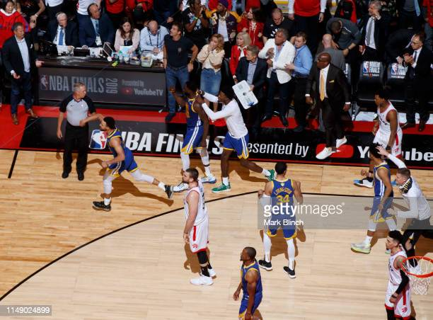 Stephen Curry of the Golden State Warriors runs up court and celebrates against the Toronto Raptors during Game Five of the NBA Finals on June 10,...