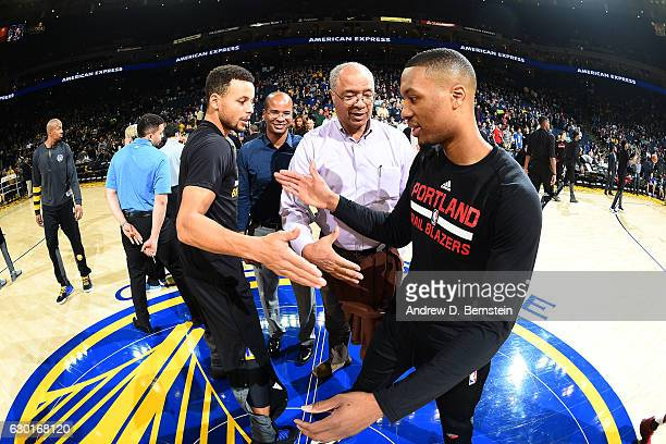 Stephen Curry of the Golden State Warriors shakes hands with Damian Lillard of the Portland Trail Blazers before the game on December 17 2016 in...