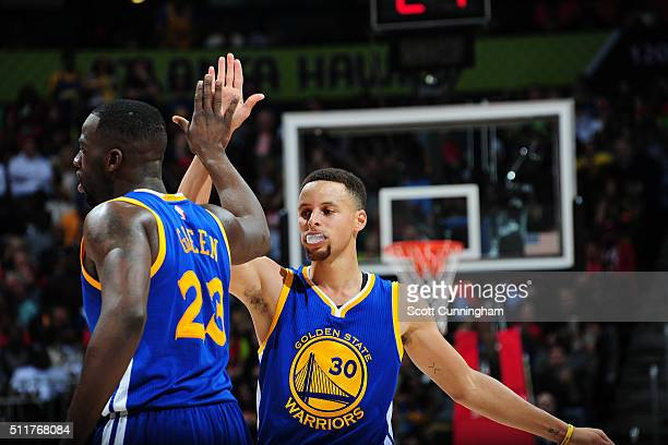 Stephen Curry of the Golden State Warriors shakes hands with Draymond Green of the Golden State Warriors during the game against the Atlanta Hawks on...