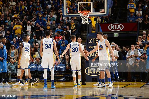 Stephen Curry of the Golden State Warriors shakes hands with his teammates during the game against the Dallas Mavericks on March 25 2016 at ORACLE...