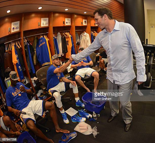 Stephen Curry of the Golden State Warriors shakes hands with Luke Walton assistant coach of the Golden State Warriors before the game against the...