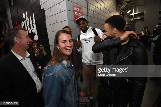 Stephen Curry of the Golden State Warriors shares a laugh with Oregon Ducks Basketball Player Sabrina Ionescu after advancing to the NBA Finals...
