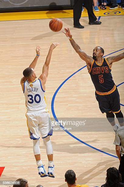 Stephen Curry of the Golden State Warriors shoos the ball over JR Smith of the Cleveland Cavaliers during Game Two of the 2016 NBA Finals on June 5...