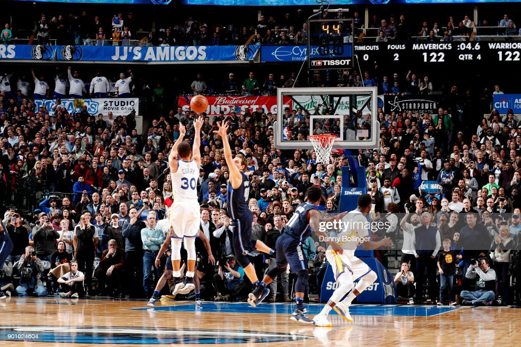 Stephen Curry #30 of the Golden State Warriors shoots a 3 late in the 4th quarter to win the game against the Dallas Mavericks on January 3, 2018 at the American Airlines Center in Dallas, Texas.
