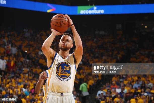 Stephen Curry of the Golden State Warriors shoots a foul shot against the Cleveland Cavaliers in Game Five of the 2017 NBA Finals on June 12 2017 at...
