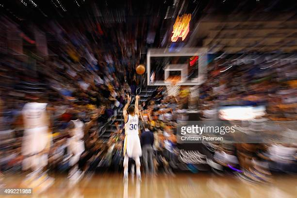 Stephen Curry of the Golden State Warriors shoots a free throw shot against the Phoenix Suns during the NBA game at Talking Stick Resort Arena on...