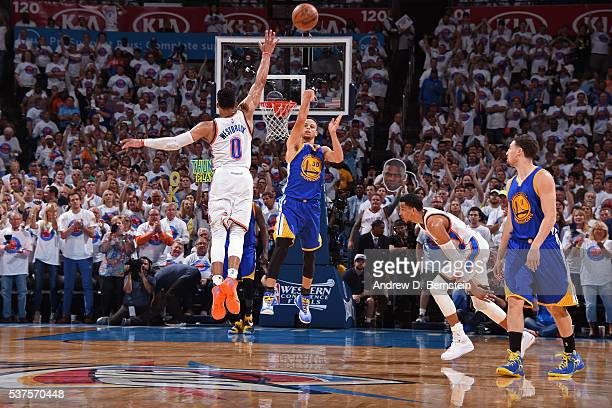 Stephen Curry of the Golden State Warriors shoots a half court shot over Russell Westbrook of the Oklahoma City Thunder in Game Four of the Western...