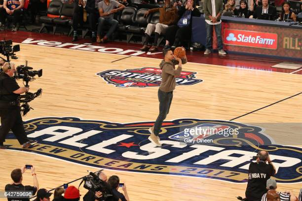 Stephen Curry of the Golden State Warriors shoots a half court shot for charity after the JBL ThreePoint Contest during State Farm AllStar Saturday...