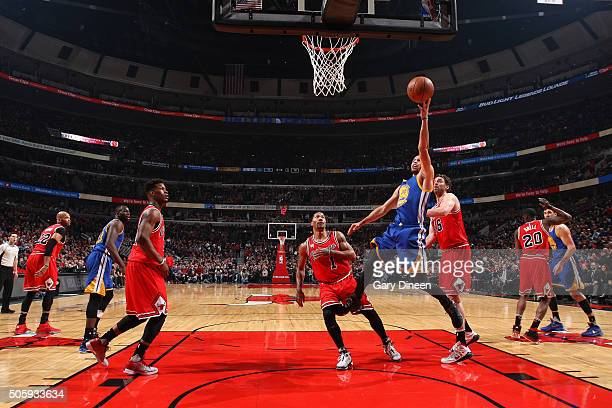 Stephen Curry of the Golden State Warriors shoots a layup during the game against the Chicago Bulls on January 20 2016 at the United Center in...